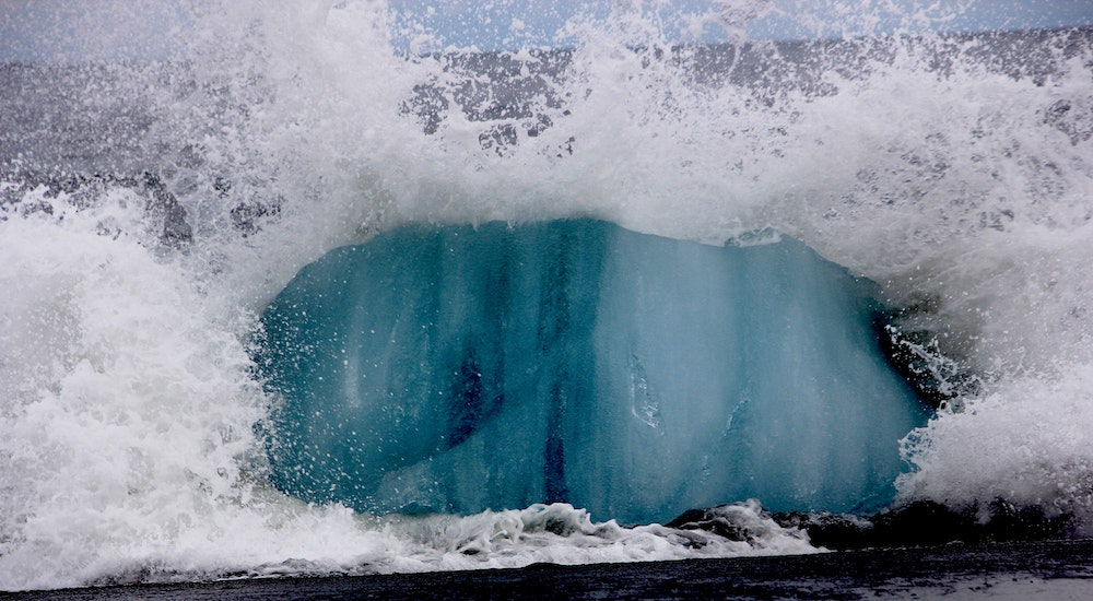wave impacting into icy rock